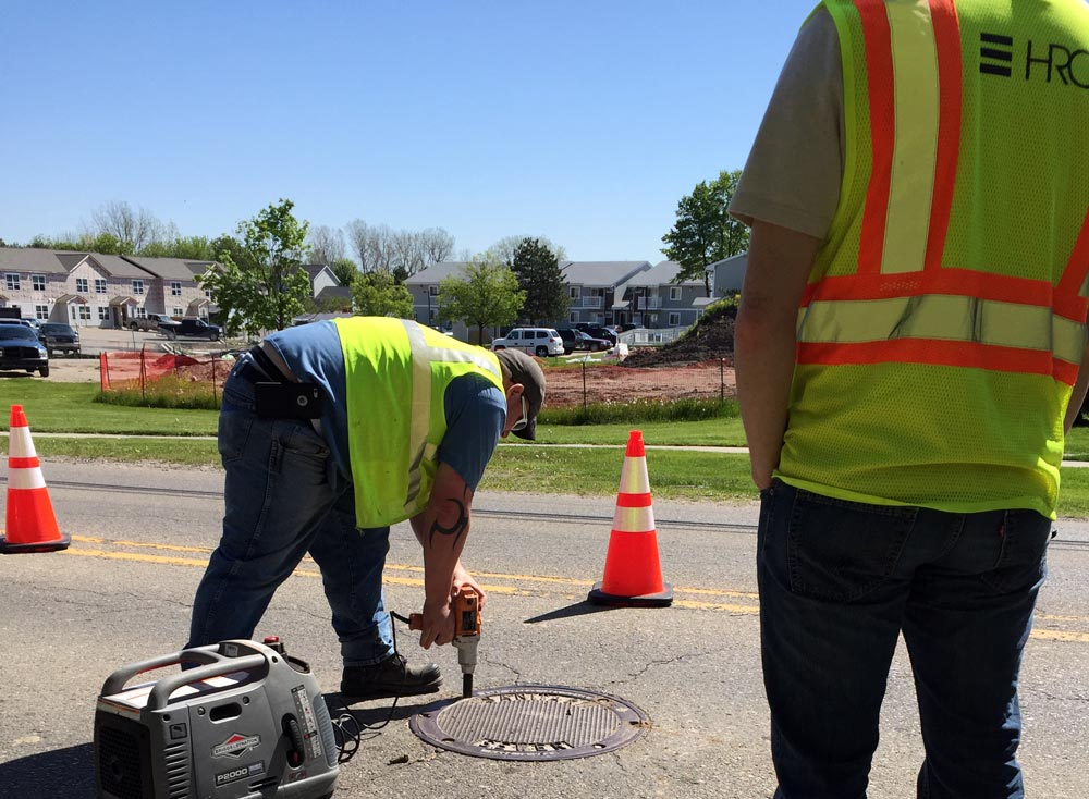 hrc crew on scene accessing a manhole